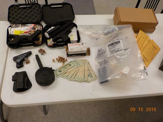 Detectives seized drugs, cars and cash while serving a search warrant on the city's north side.