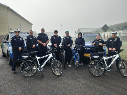 Aumsville Police assisting with the Bike/Walk to School Wednesday, Oct. 25, left to right, Officer Ryan Bambrick, Sgt. Damian Flowers, Officer Carl Gabba, Officer Jordan Largent, Chief Richard Schmitz, Police Support Specialist Brenda Campbell, Officer Shane Bird, and Officer Brian Buchholz.