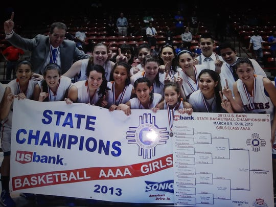 Teige Zeller, top second from left, and her father Marty, top left, celebrate their 2013 New Mexico state basketball title.