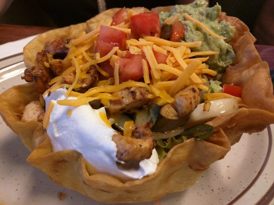El Tapatio Mexican Grill's fajita salad was a warm, crisp, crunchy shell topped with thinly sliced marinated charbroiled chicken, onions, peppers, guacamole, cheese and sour cream.