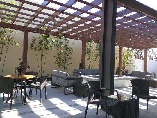 Outdoor dining area of Post & Vine in Vero Beach. The