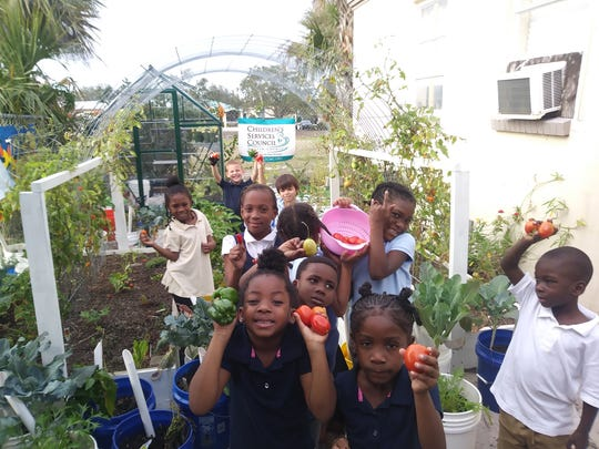 Students at the Banner Lake Club learn about gardening