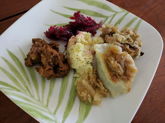 Eva's Polish KItchen's side dishes: beets, dumplings, red cabbage,  sauerkraut and mashed potatoes.