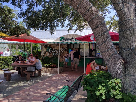 Casey's Place sits behind old majestic live oak trees.