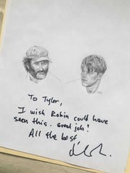 Actor Matt Damon signed a drawing Tyler Moy did of