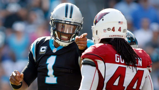 Panthers' Cam Newton (1) objects to a late hit by Cardinals' Markus Golden (44) in the second half in Charlotte, N.C., Sunday, Oct. 30, 2016.