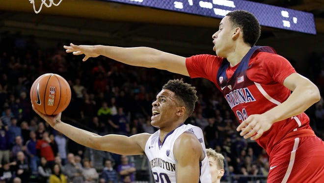 Arizona's Chance Comanche, right, defends as Washington's Markelle Fultz looks for a shot in the second half Saturday.