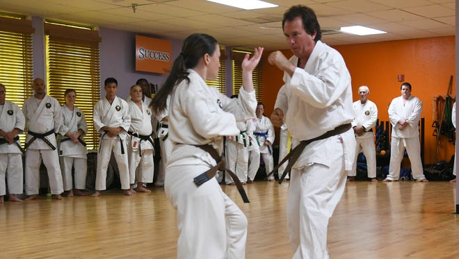 Brittany Stanley and her father Bill perform an advanced fighting drill at Cocoa Beach Karate Saturday.