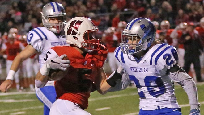 Homestead's Bradley Woldt (shown vs. Whitefish Bay)  was one of three players that took snaps for Homestead at quarterback.