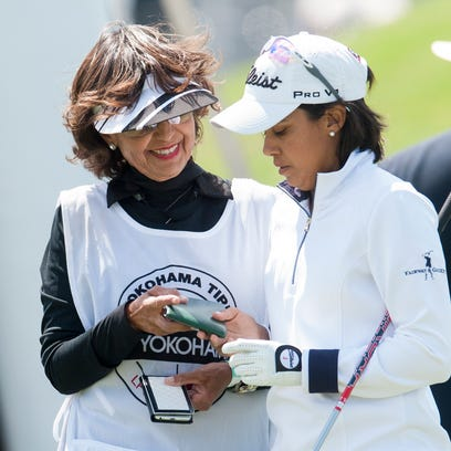 Julieta Granada, right, works with her mother and caddie