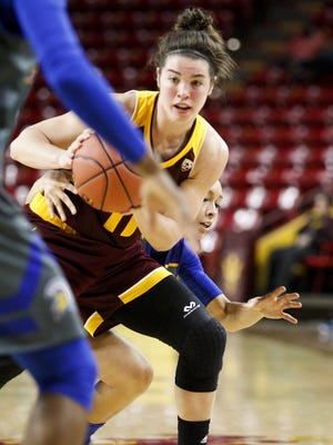 ASU freshman guard Robbi Ryan (11) looks to pass under pressure from San Jose State defenders in the second half at Wells Fargo Arena in Tempe on Sunday, Nov. 13, 2016. The Sun Devils defeated the Spartans 82-37.