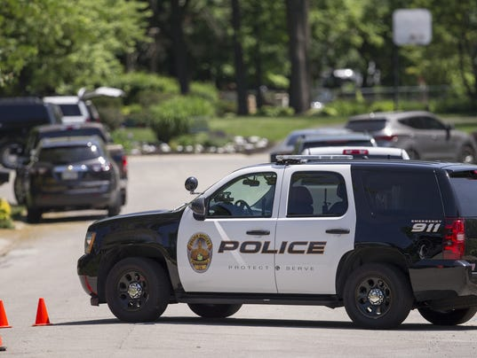 A Noblesville police cruiser blocks access to Roxbury Lane in Noblesville, where authorities are serving a warrant following a shooting at Noblesville West Middle School, just after 9 a.m.