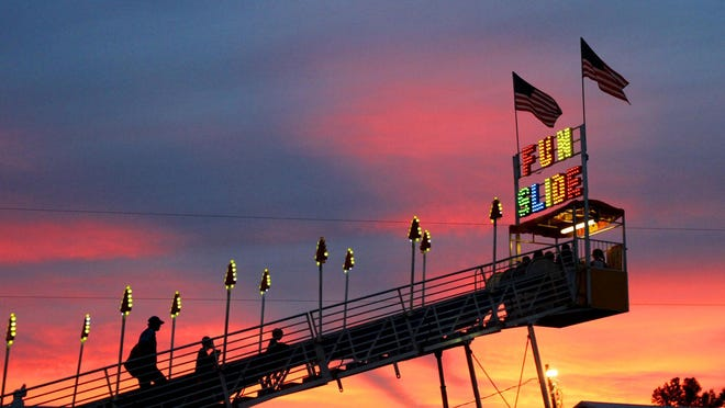 Riders climb to the top of the Fun Slide as a summer sun sets at the Marion County Fair. Rides are a big part of the fun at the fair each year.