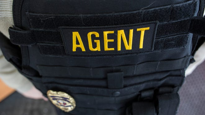 Kevin Schalm, owner of 123 You're Free bail bonds, occasionally has to act as a recovery agent, or bounty hunter, if clients fail to appear for court. Schalm will carry handcuffs and wears a bullet-proof vest.