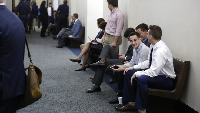 FSU students wait in the halls at the Leon County Courthouse Monday to be questioned by the grand jury investigating the death of fraternity pledge Andrew Coffey.