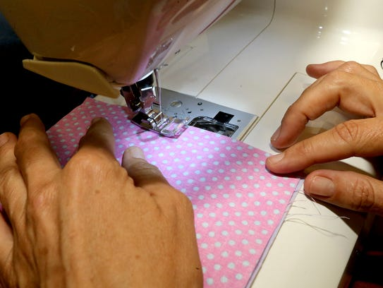 Brenda Collier uses a sewing machine to sew her quilting