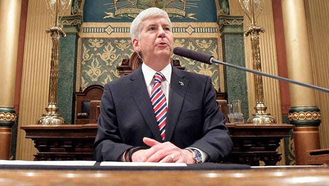 Michigan Gov. Rick Snyder delivers his State of the State address to a joint session of the House and Senate, in the House Chambers of the state Capitol in Lansing, Mich.
