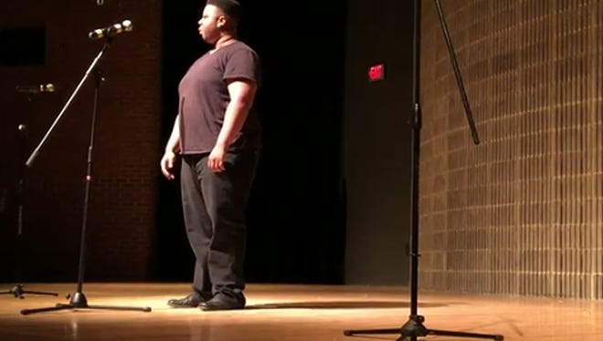 Chi the Realist performs at the Fringe Festival.