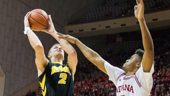 Iowa Hawkeyes forward Jack Nunge (2) shoots the ball and is fouled by Indiana Hoosiers forward Juwan Morgan (13) in the second half of the game at Assembly Hall.