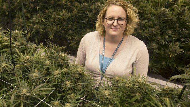 Amanda Woods, marketing manager and compliance officer at Choice Organics, poses for a portrait in the dispensary's grow room on Wednesday, April 26, 2017. Woods says it is difficult for her and other workers in the marijuana industry to acquire things like bank loans due to the nature of their work.