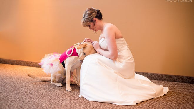 Valerie Parrott and her service dog, Bella, share a sweet moment at Parrott's wedding at Rustic Hills Community Church in Sioux Falls on Saturday.