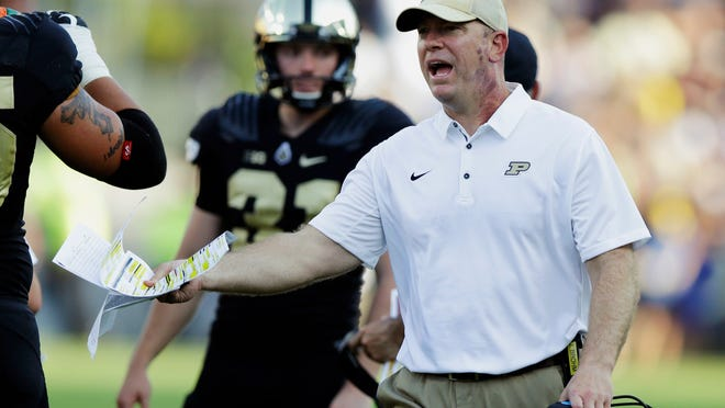 Purdue head coach Jeff Brohm yells to an official during the first half of an NCAA college football game against Michigan on Sept. 23.