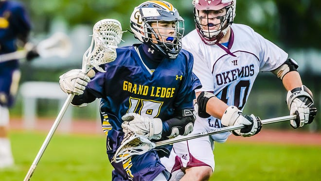 Jackson Alspaugh ,left, of Grand Ledge is the top assists leader in the Lansing area.