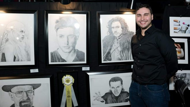 Nicholas Sacks in front of some of his pieces at an art show, many of his pieces will be shown at the Art and Soul Fine Art Exhibit and Sale on Saturday, March 24.
