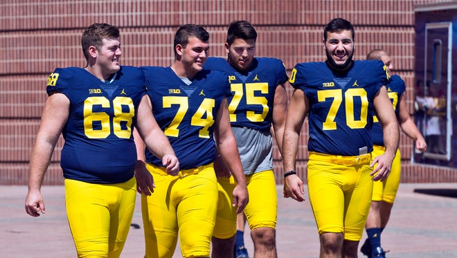 True freshman Ben Bredeson (74) is pushing to start for Michigan on the offensive line.