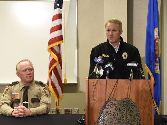 Aitkin County Sheriff Scott Turner listened while Drew