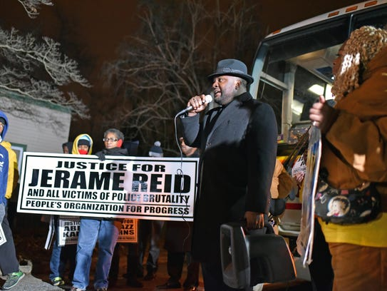 Activist Walter Hudson speaks at a rally and march