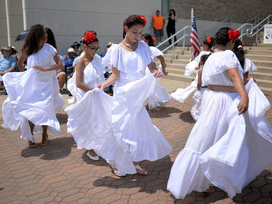 Pageant queens of the festival perform a dance during