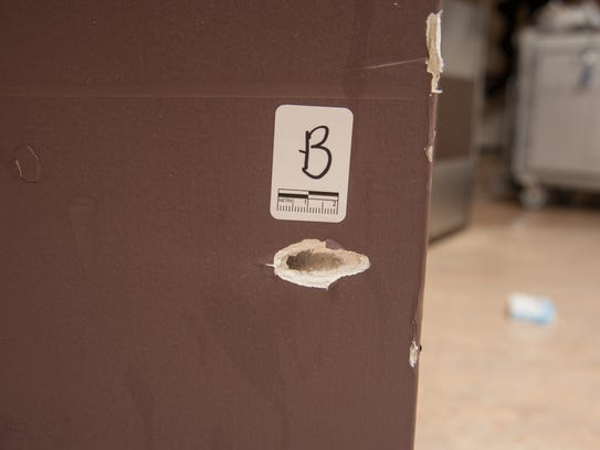 A close-up of one of the bullet holes in the hospital