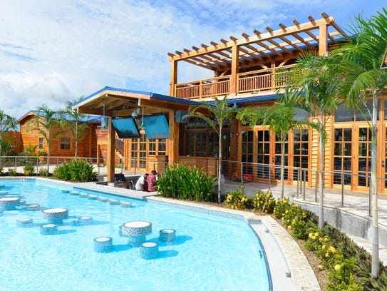The Harvest Caye pool features a swim-up bar that is