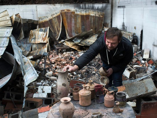 Artist Tommy Bullen salvages fire-damaged pottery at