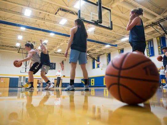 The Littlestown girls' basketball team run through