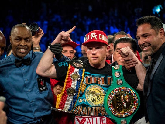 Canelo Alvarez poses for a photo after defeating Amir