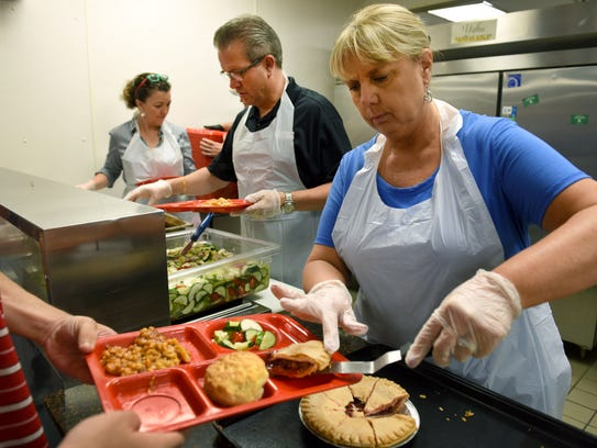 Becky Parker dishes a slice of pie while volunteering