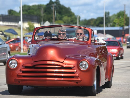 A custom chopped Mercury cruises the loop for the Woodward