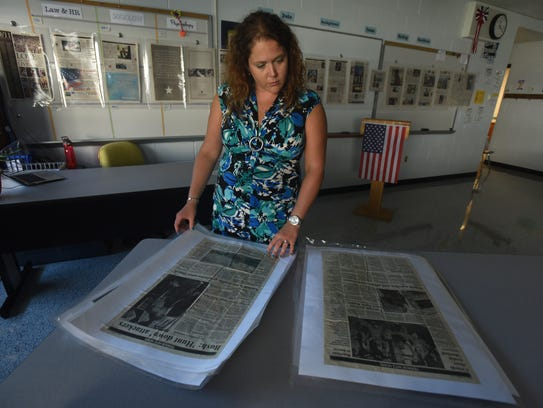 Christine Kamper uses laminated newspaper pages to
