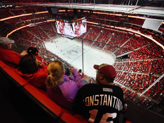 Red Wings fans sit along the glass in the West gondola