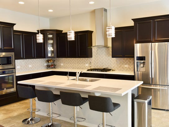 Guests enjoy bar-style seating at the extra-large kitchen