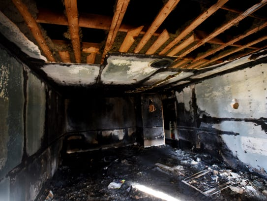 The living room after the fire of Schmid house.