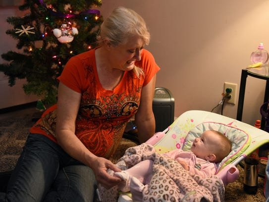 Tammy Bolling plays with her granddaughter Stella Rose
