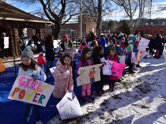 Leonia girl scouts deliver a message at the march.