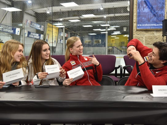 Canadian ice dancer Andrew Poje takes a photo of (L to R) Nicole Rajicova of Slovakia, Alexia Paganini of Switzerland and Poje's partner Kaitlyn Weaver during a press conference at the Ice House, which is celebrating its 20th anniversary.