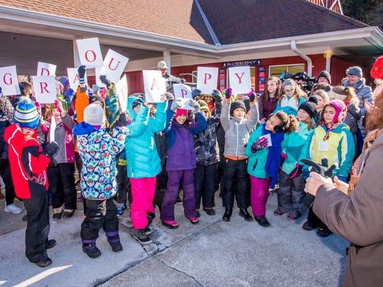 Children from Milwaukee Montessori School perform at