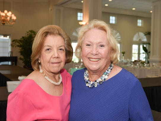 Event co-chair Henriette Churney, left, and Carole