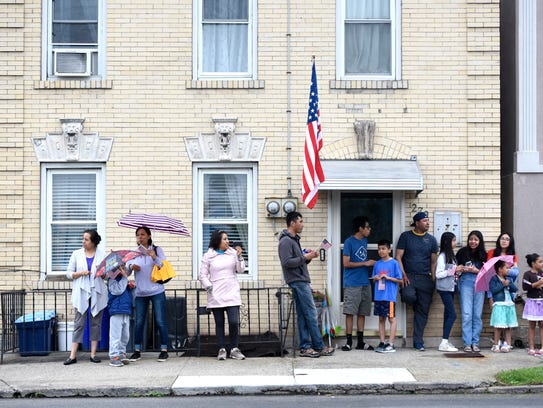 People wait for the Memorial Day parade to begin during