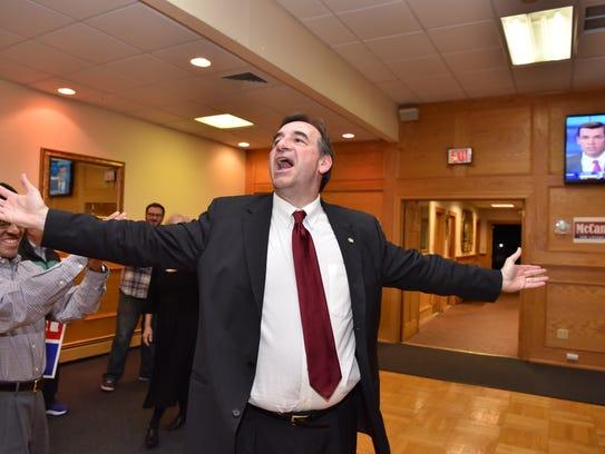 John McCann celebrates victory in Ramsey